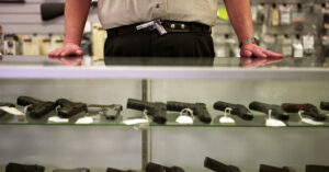 Robber Pepper Sprays Gun Store Worker, Gets Shot For His Stupidity