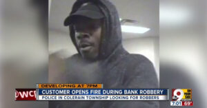 Bank Robber And Customer Exchange Gunfire