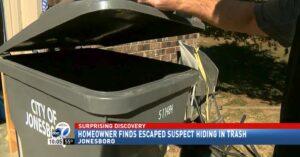 Escaped Suspect Hides In Trash Can, Homeowner Finds Him And Holds Him At Gunpoint