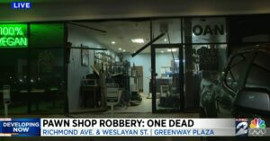 Smash And Grab Pawn Shop Robbery Leads To Hostage Situation, One Robber Dead